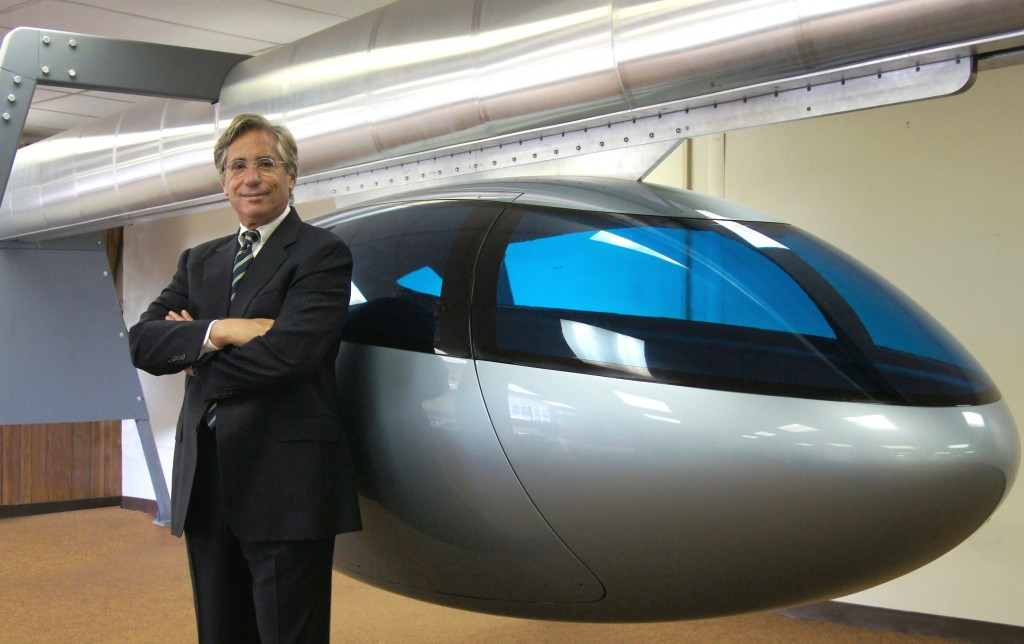 Mr Jerry Sander Posing With SkyTran Cabin