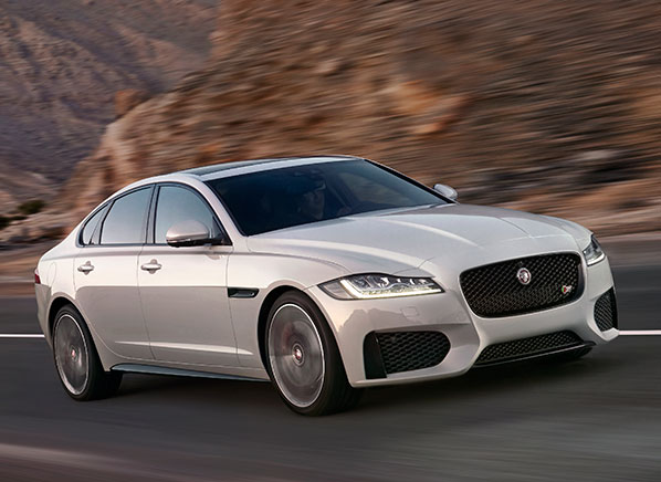 2016-Jaguar-XF-S-pr-white-driving-598